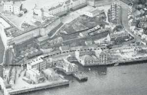 The water-front buildings that formed part of the Victualling Office and later the Emigration Depot.