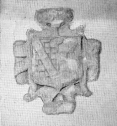 The remains of the keystone at Friary Court, Plymouth, showing the arms of Jonathan Sparke.