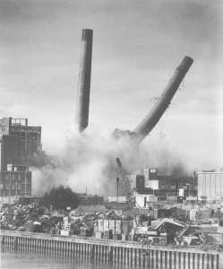 'Ebb' and 'Flo', the chimneys at Prince Rock power station fall during demolition work.