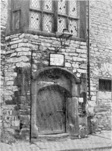 the doorway of the Prysten House, Plymouth, just before restoration commenced.